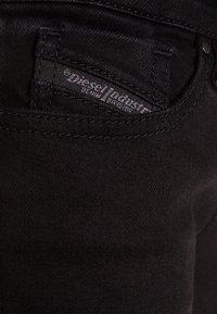 Diesel - SLEENKER-J-N PANTALONI - Jean slim - black denim - 2
