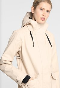 Didriksons - BOJAN WOMENS JACKET - Waterproof jacket - beige - 3