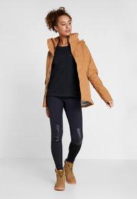 Didriksons - UNN WOMENS JACKET - Outdoor jacket - almond brown - 1