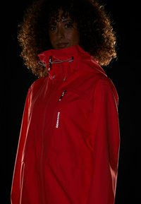 Didriksons - WIDA WOMENS JACKET - Hardshell jacket - coral red - 7