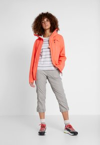 Didriksons - WIDA WOMENS JACKET - Hardshell jacket - coral red - 1