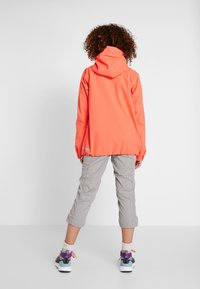 Didriksons - WIDA WOMENS JACKET - Hardshell jacket - coral red - 2