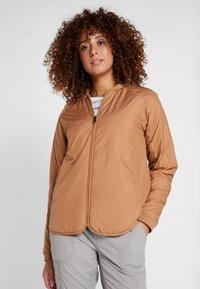 Didriksons - JUNI WOMENS JACKET - Outdoor jacket - almond brown - 0