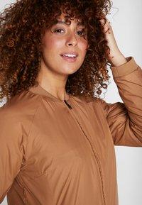 Didriksons - JUNI WOMENS JACKET - Outdoor jacket - almond brown - 4