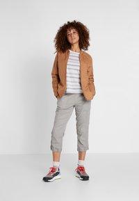Didriksons - JUNI WOMENS JACKET - Outdoor jacket - almond brown - 1
