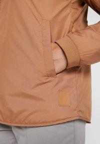 Didriksons - JUNI WOMENS JACKET - Outdoor jacket - almond brown - 6
