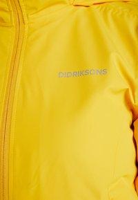 Didriksons - NOOR WOMENS - Waterproof jacket - oat yellow - 10