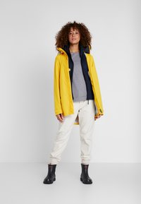 Didriksons - NOOR WOMENS - Waterproof jacket - oat yellow - 1