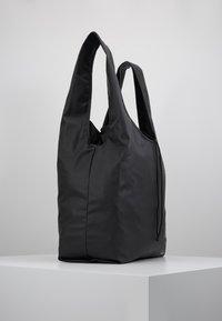 Didriksons - SKAFTÖ GALON BAG - Sports bag - black - 3