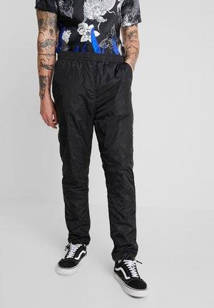 MONOGRAM TRACK PANTS - Pantaloni sportivi - black