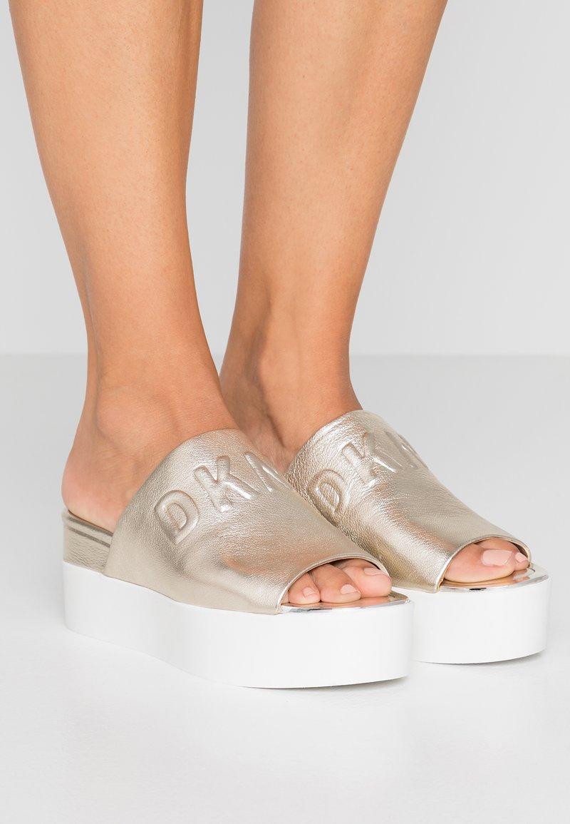 DKNY - COVO PLATFORM SLID - Heeled mules - platinum