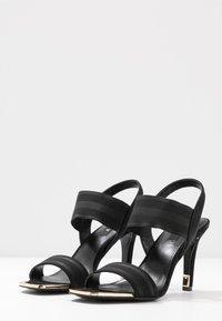 DKNY - BRYSON MULTI STRAP SLINGBACK  - Højhælede sandaletter / Højhælede sandaler - black - 4