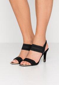 DKNY - BRYSON MULTI STRAP SLINGBACK  - Højhælede sandaletter / Højhælede sandaler - black - 0