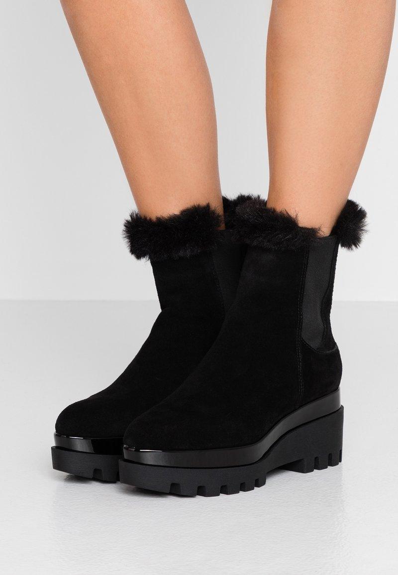 DKNY - BAX BOOTIE - Platform ankle boots - black