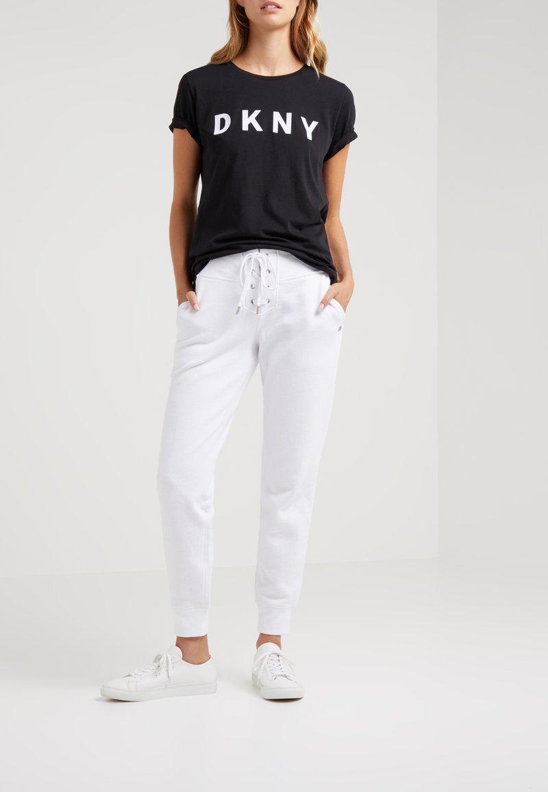 DKNY - Tracksuit bottoms - white