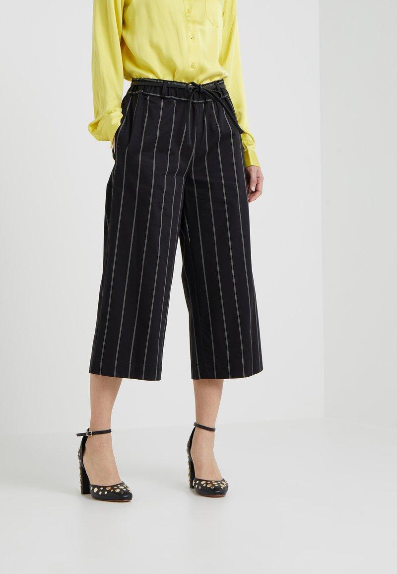DKNY - Trousers - black/white