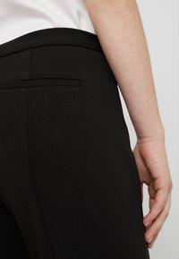 DKNY - FOUNDATION PANT SIDE SLITS - Tygbyxor - black - 3