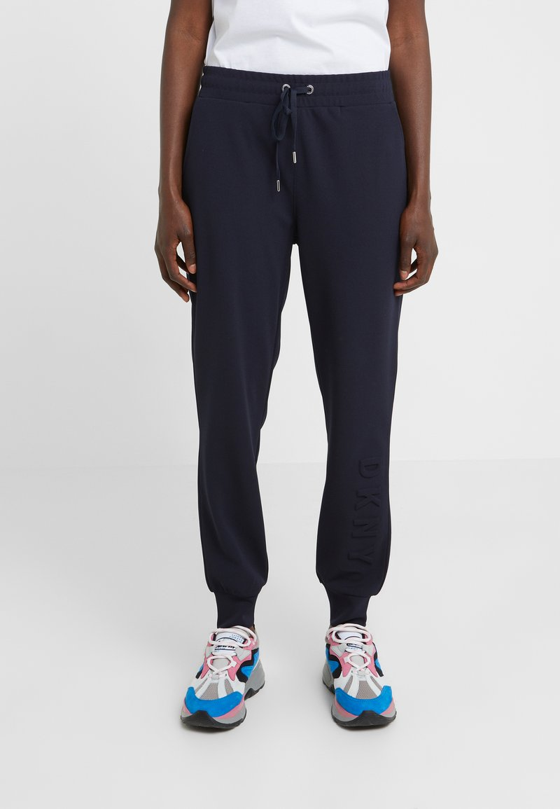 DKNY - EMBOSSED LOGO - Tracksuit bottoms - new navy