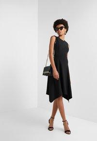 DKNY - CREW NECK HANDKERCHIEF DRESS - Jerseyklänning - black - 1