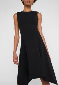 DKNY - CREW NECK HANDKERCHIEF DRESS - Jerseyklänning - black - 5