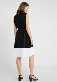 DKNY - V-NECK FAUX WRAP STITCHED A-LINE - Day dress - black/ivory - 2