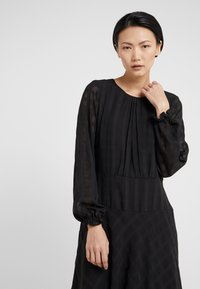 DKNY - FIT FLARE WITH DOUBLE LAYER SKIRT - Day dress - black - 5