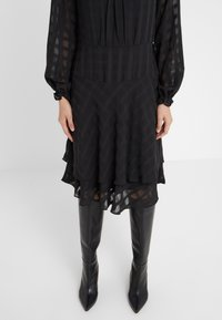 DKNY - FIT FLARE WITH DOUBLE LAYER SKIRT - Day dress - black - 3