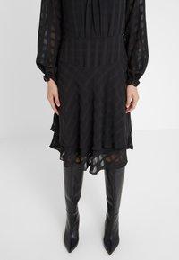 DKNY - FIT FLARE WITH DOUBLE LAYER SKIRT - Denní šaty - black - 3