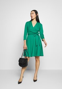 DKNY - 3/4 SLEEVE FAUX WRAP BODICE FIT FLARE - Day dress - emerald - 1