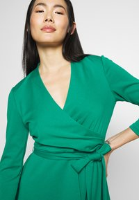DKNY - 3/4 SLEEVE FAUX WRAP BODICE FIT FLARE - Day dress - emerald - 5