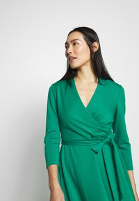 DKNY - 3/4 SLEEVE FAUX WRAP BODICE FIT FLARE - Day dress - emerald - 3