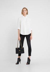 DKNY - FOUNDATION ROLL TAB THRU HIDDEN PLACKET - Skjortebluser - ivory - 1