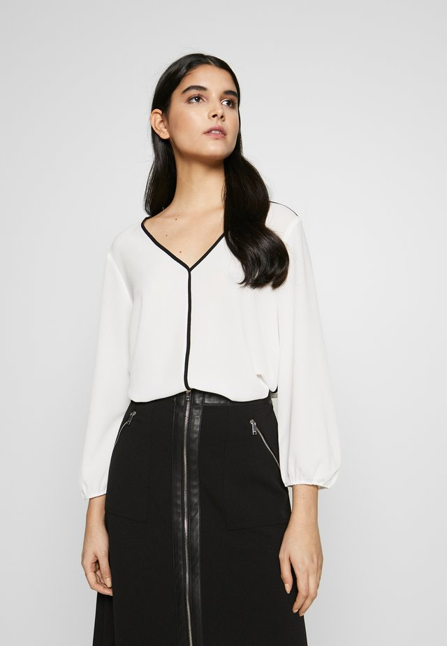 V-NECK PIPING - Blouse - ivory/blac