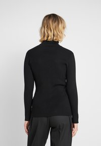 DKNY - SOLID TURTLENECK - Strickpullover - black - 2