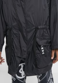DKNY - THE WAIST COAT POCKETS - Pitkä takki - black - 6