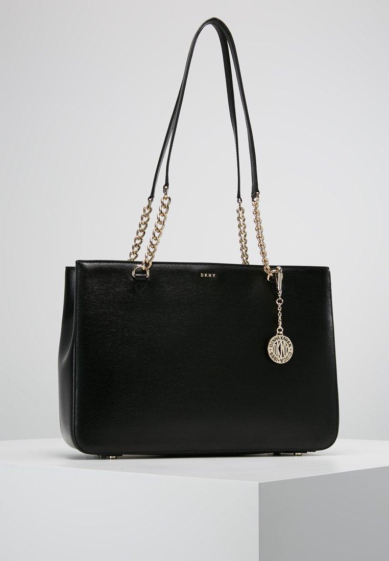 DKNY - BRYANT SHOP TOTE - Handbag - black/gold