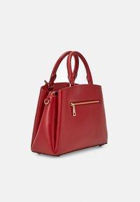 DKNY - SATCHEL - Handbag - bright red - 1