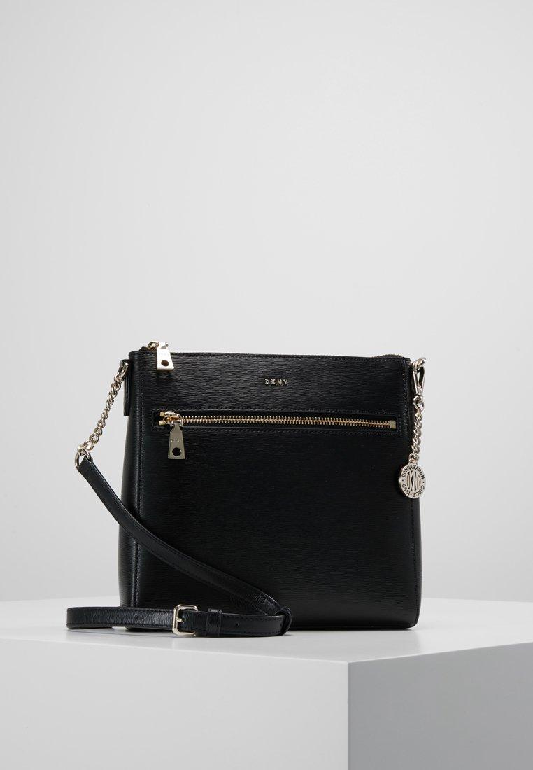 DKNY - BRYANT - Across body bag - black/gold