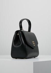 DKNY - WHITNEY SATCHEL - Across body bag - black/gold - 3