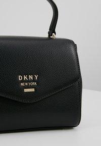 DKNY - WHITNEY SATCHEL - Across body bag - black/gold - 6
