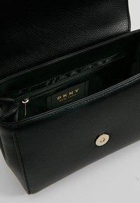 DKNY - WHITNEY SATCHEL - Across body bag - black/gold - 4