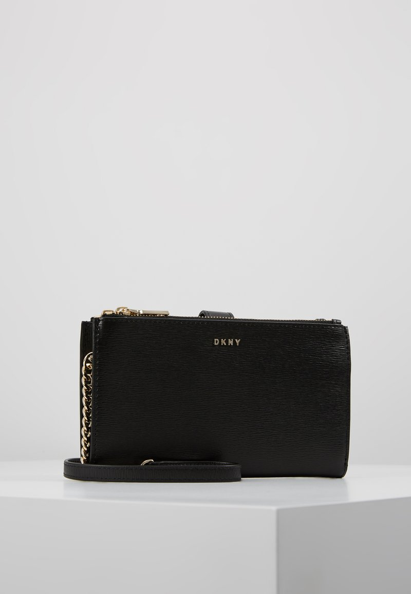 DKNY - BRYANT DOUBLE ZIP CBODY WALLET - Umhängetasche - black/gold-coloured