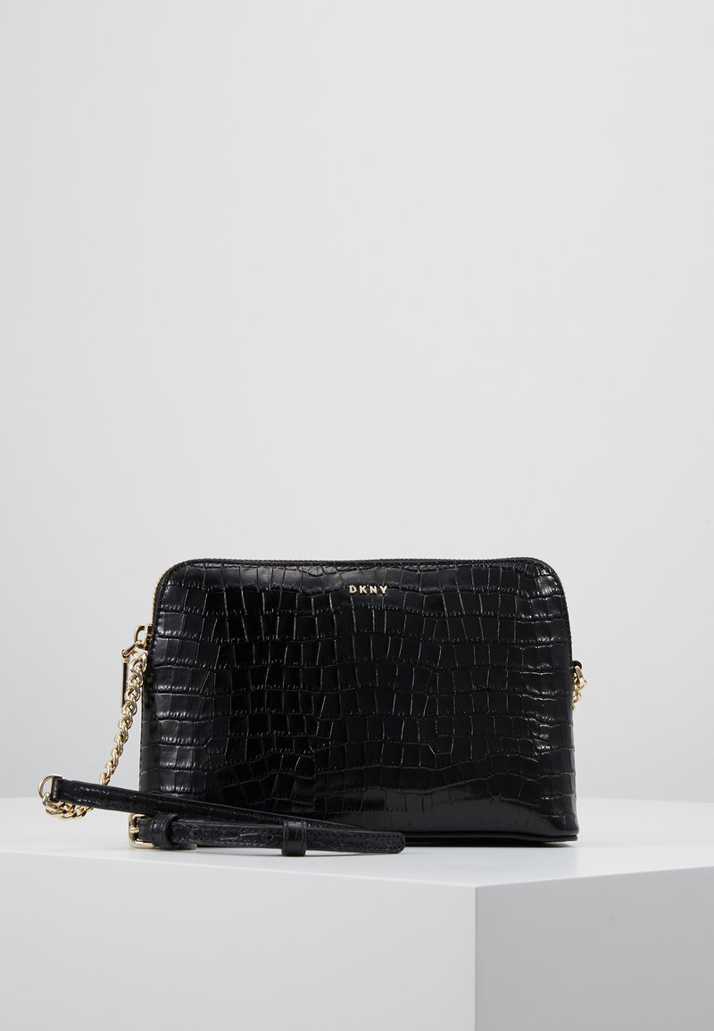 DKNY - BRYANT DOME CROSSBODY - Across body bag - black/gold-coloured