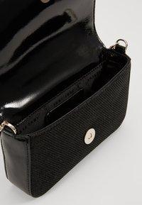 DKNY - ITEM DEMI FLAP CROSSBODY GLITTER - Across body bag - black/gold - 4