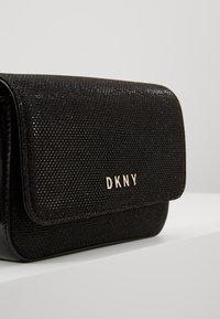 DKNY - ITEM DEMI FLAP CROSSBODY GLITTER - Across body bag - black/gold - 7