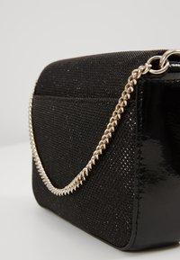 DKNY - ITEM DEMI FLAP CROSSBODY GLITTER - Across body bag - black/gold - 5