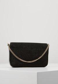 DKNY - ITEM DEMI FLAP CROSSBODY GLITTER - Across body bag - black/gold - 2