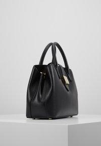 DKNY - LYLA CENTER ZIP SATCHEL SUTTON - Handbag - black/gold - 3