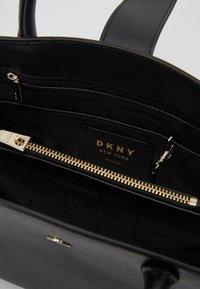DKNY - LYLA CENTER ZIP SATCHEL SUTTON - Handbag - black/gold - 4