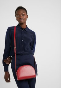 DKNY - SUTTON DOME XBODY - Across body bag - bright red - 1